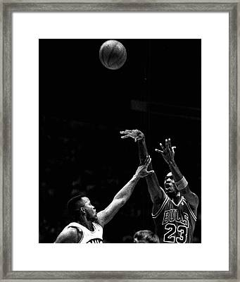 Michael Jordan Shooting Over Another Player Framed Print by Retro Images Archive