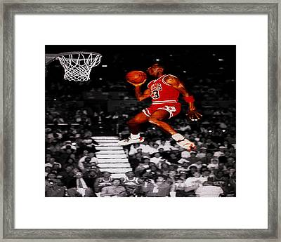 Michael Jordan Suspended In Mid Air Framed Print by Brian Reaves