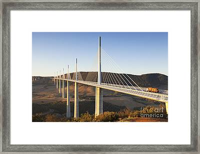 Millau Viaduct At Sunrise Midi Pyrenees France Framed Print by Colin and Linda McKie