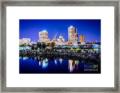 Milwaukee Skyline At Night Photo In Blue Framed Print by Paul Velgos