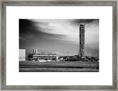 mobile launcher platform and crawler transporters and launch service structure gantry at Kennedy Spa Framed Print by Joe Fox