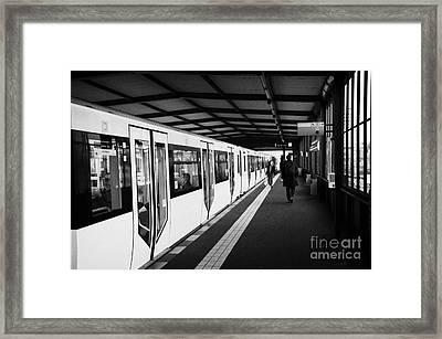 modern yellow u-bahn train sitting at station platform Berlin Germany Framed Print by Joe Fox