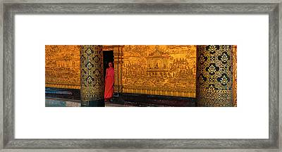 Monk In Prayer Hall At Wat Mai Buddhist Framed Print by Panoramic Images