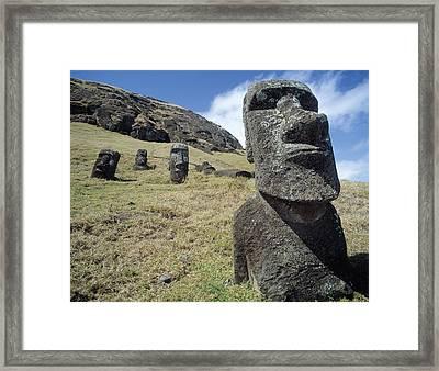 Monolithic Statues At Rano Raraku Quarry Framed Print by English School