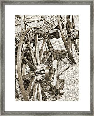 Montana Old Wagon Wheels In Sepia Framed Print by Jennie Marie Schell