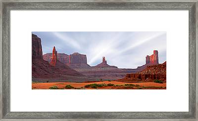 Monument Valley At Sunset Panoramic Framed Print by Mike McGlothlen