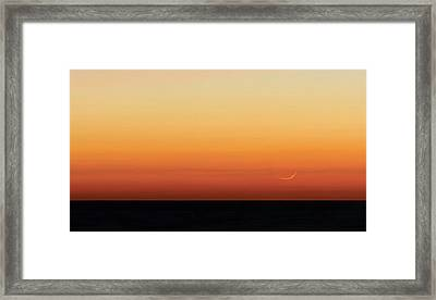 Moon At Sunrise Over The Sea Framed Print by Luis Argerich
