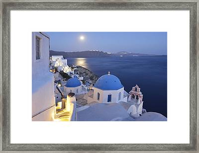 Moon Over The Island Framed Print by Christian Heeb