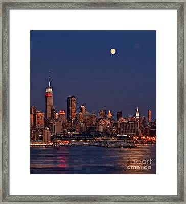 Moon Rise Over Manhattan Framed Print by Susan Candelario