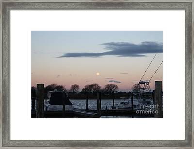 Moon Setting Over The Marina Framed Print by John Telfer