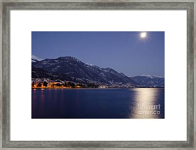Moonlight Over A Lake Framed Print by Mats Silvan