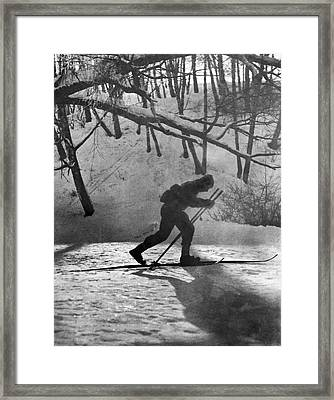 Moonlight Skiing In Russia Framed Print by Underwood Archives
