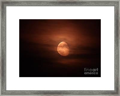 Moonrise Through Clouds Framed Print by John Chumack