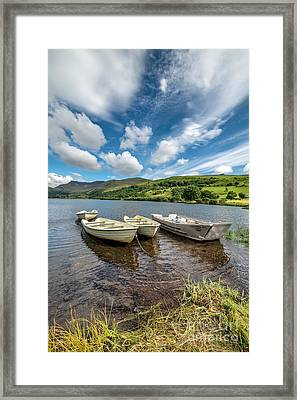 Moored Boats  Framed Print by Adrian Evans