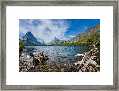 Morning Colors Of Swiftcurrent Lake Framed Print by Greg Nyquist
