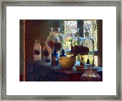 Mortar And Pestle And Bottles By Window Framed Print by Susan Savad