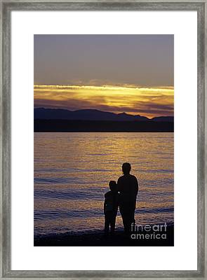 Mother And Daughter Holding Each Other Along Edmonds Beach At Su Framed Print by Jim Corwin
