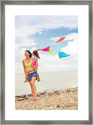 Mother And Daughter On Beach Framed Print by Ian Hooton