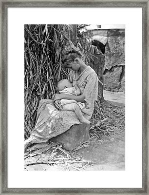 Mother Breast Feeding A Baby Framed Print by Underwood Archives