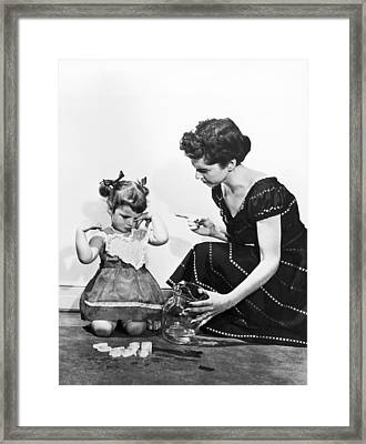Mother Scolding Tearful Child Framed Print by Underwood Archives