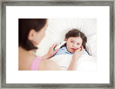 Mother Taking Daughter's Temperature Framed Print by Ian Hooton