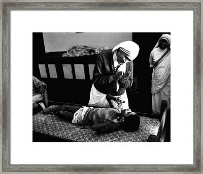 Mother Teresa Helping Boy Framed Print by Retro Images Archive