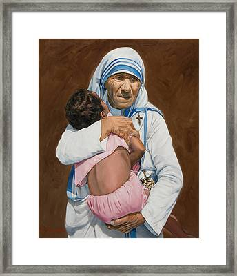 Mother Teresa Holding A Child Framed Print by Dominique Amendola