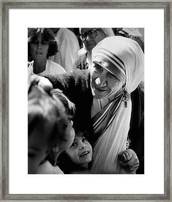 Mother Teresa With Children Framed Print by Retro Images Archive