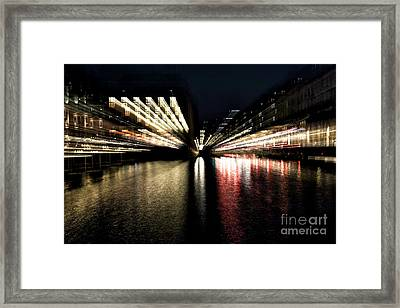 Motion On The Canal Framed Print by John Rizzuto