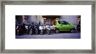 Motor Scooters With A Car Parked Framed Print by Panoramic Images