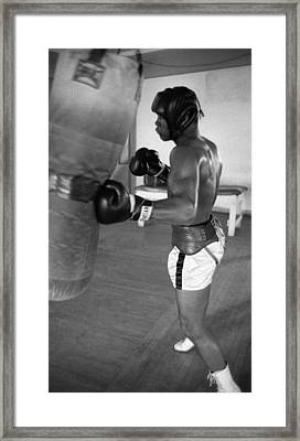 Ali Punching Bag Framed Print by Retro Images Archive