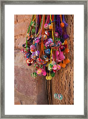 Multi-colored Hangings On Wall, Tulmas Framed Print by Panoramic Images