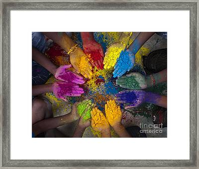 Multicoloured Hands Framed Print by Tim Gainey