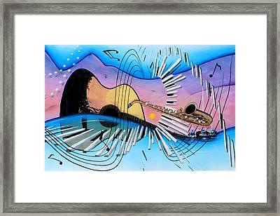 Musica Framed Print by Angel Ortiz