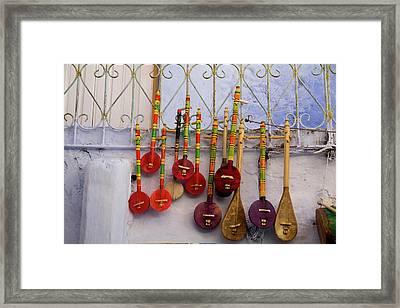 Musical Instrument, Souvenir Shops Framed Print by Emily Wilson