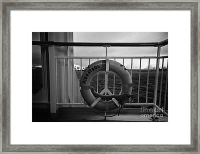 Mv Midnatsol Lifebelt On Board Hurtigruten Passenger Ship Sailing Through Fjords During Winter Framed Print by Joe Fox