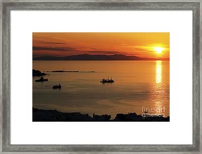 Mykonos Sunset Framed Print by John Rizzuto