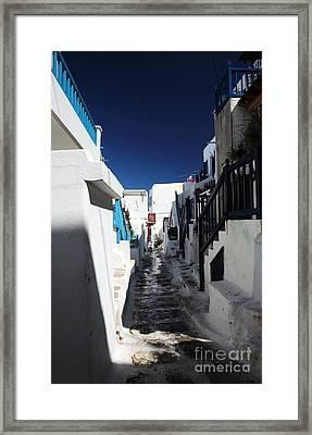 Mykonos Town Street Shadows Framed Print by John Rizzuto