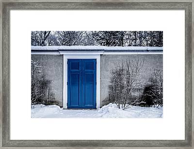 Mysterious Blue Door On Wall Framed Print by Edward Fielding