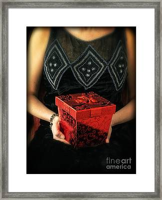 Mysterious Woman With Red Box Framed Print by Edward Fielding
