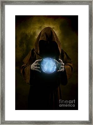 Mystery Man Wearing Cloak With Hood And Blue Glowing Crystal Ball Between His Hands Framed Print by Jaroslaw Blaminsky