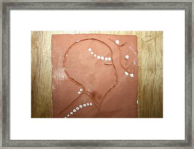Naomi - Tile Framed Print by Gloria Ssali