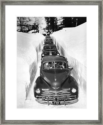 Narrow Winter Road Framed Print by Underwood Archives