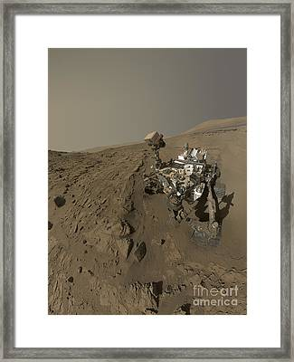 Nasas Curiosity Mars Rover On Planet Framed Print by Stocktrek Images