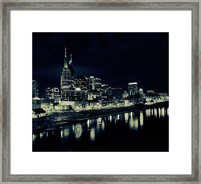 Nashville Skyline Reflected At Night Framed Print by Dan Sproul
