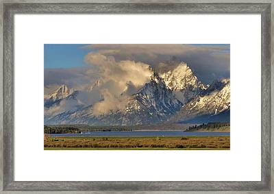 Teton Mountain Range In Clouds Framed Print by Dan Sproul