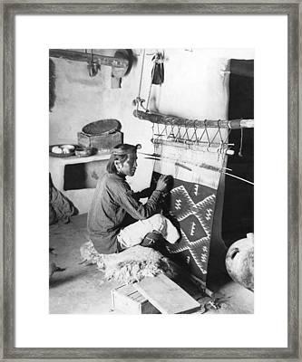 Navajo Man Weaving A Blanket Framed Print by Underwood Archives