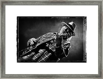 Neil Young On Guitar In Black And White With Grungy Frame  Framed Print by Jennifer Rondinelli Reilly