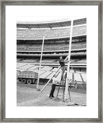 New York Jets Football Crew Works On Field Goal Repairs Framed Print by Retro Images Archive