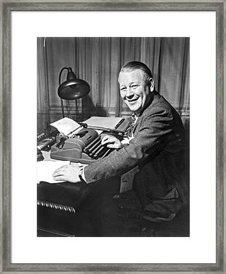 Newspaper Reporter At Work Framed Print by Underwood Archives